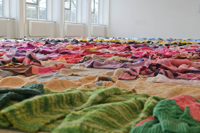 Hundreds of sweaters knitted by Loes Veenstra