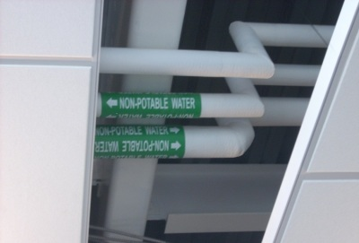 """Water pipes in the CSL marked """"nonpotable,"""" used for flushing toilets."""