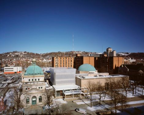 """The """"lantern"""" building joins the historic Allegheny Post Office and former Buhl Planetarium. Ned Kahn's 40,000-piece wind sculpture (center) is usually in motion. Koning Eizenberg was the project architect."""