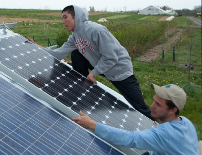 Installing solar panels at Dickinson College's farm. Photo courtesy of Jennifer Crowley.