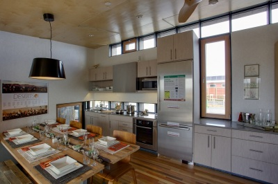 Spectacular kitchen design with soaring ceiling in the Las Vegas house -- and solar-powered to boot.