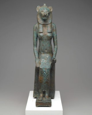 Divine Felines exhibition: Seated wadjet, late Egypt. Collection of the Brooklyn Museum