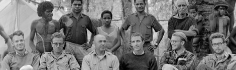 Peter Matthiessen (dark crewneck sweater front row) with Michael Rockefeller in New Guinea. Photo by Eliot Elissofon, courtesy of Harvard Peabody Museum.