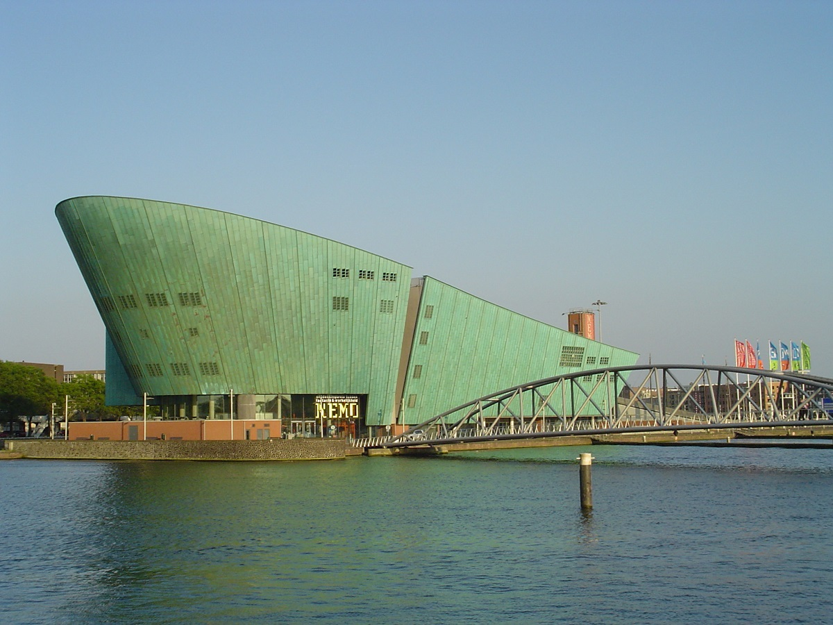 The sci-tech museum NEMO looks like a ship rising from the water. Designed by Rem Koolhaas. Courtesy of wikipedia.