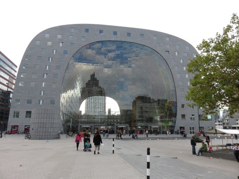 "Markthal's ""see through"" facade is an innovative cable system for suspending individual glass panels."