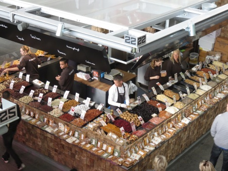 Grains and nuts in a very tidy stall, seen from a mezzanine spot