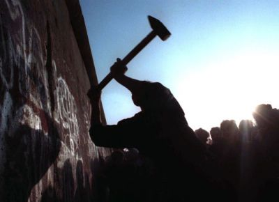 Taking down the Berlin Wall. Courtesy of Huffington Post