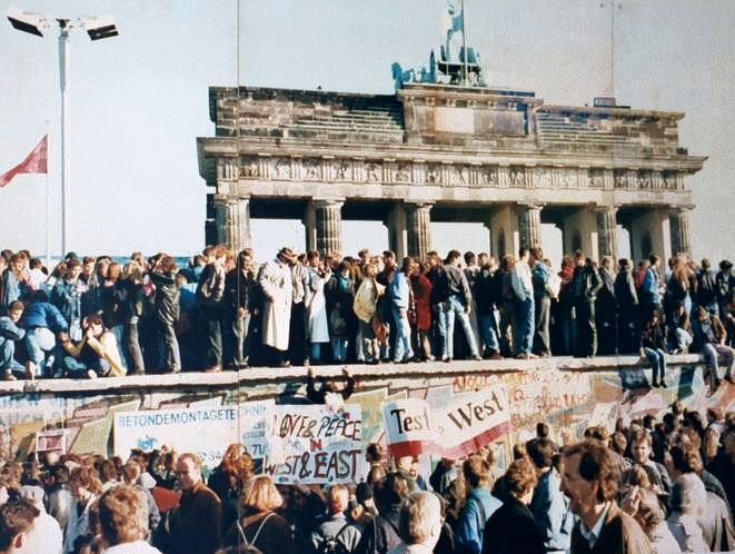 A joyous crowd atop the Berlin Wall Nov 1989. Courtesy of wikipedia
