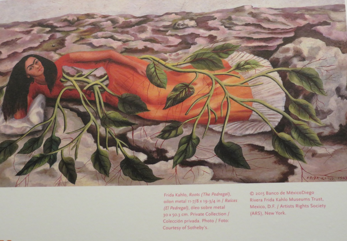 Roots (The Pedregal, 1943) While not in the exhibition, this small work on tin (privately owned) is a strong example of how Frida saw herself as part of the interconnectedness of life. Here her body opens into roots and the plants spread into the desert-like barancas terrain. (© 2015 Banco de México. Diego Rivera Frida Kahlo Museums Trust/Artist Rights Society/NYC. All rights reserved.)