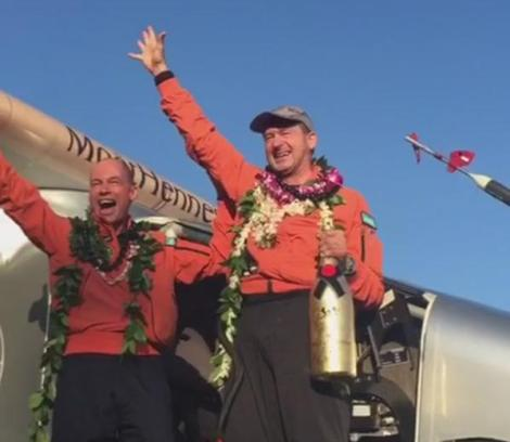 Bertrand Piccard and Andre Borschberg looking happy, proud and tired after 118 hours of continuous flight from Japan to Hawaii in their Solar Impulse 2 plane. Courtesy of  si2.