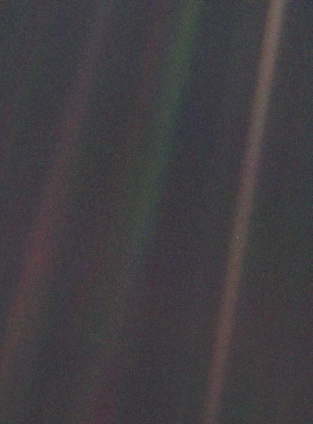 This image of Earth is one of 60 frames taken by the Voyager 1 spacecraft on February 14, 1990 from a distance of more than 6 billion kilometers (4 billion miles) and about 32 degrees above the ecliptic plane. In the image the Earth is a mere point of light, a crescent only 0.12 pixel in size. Courtesy of NASA/JPL
