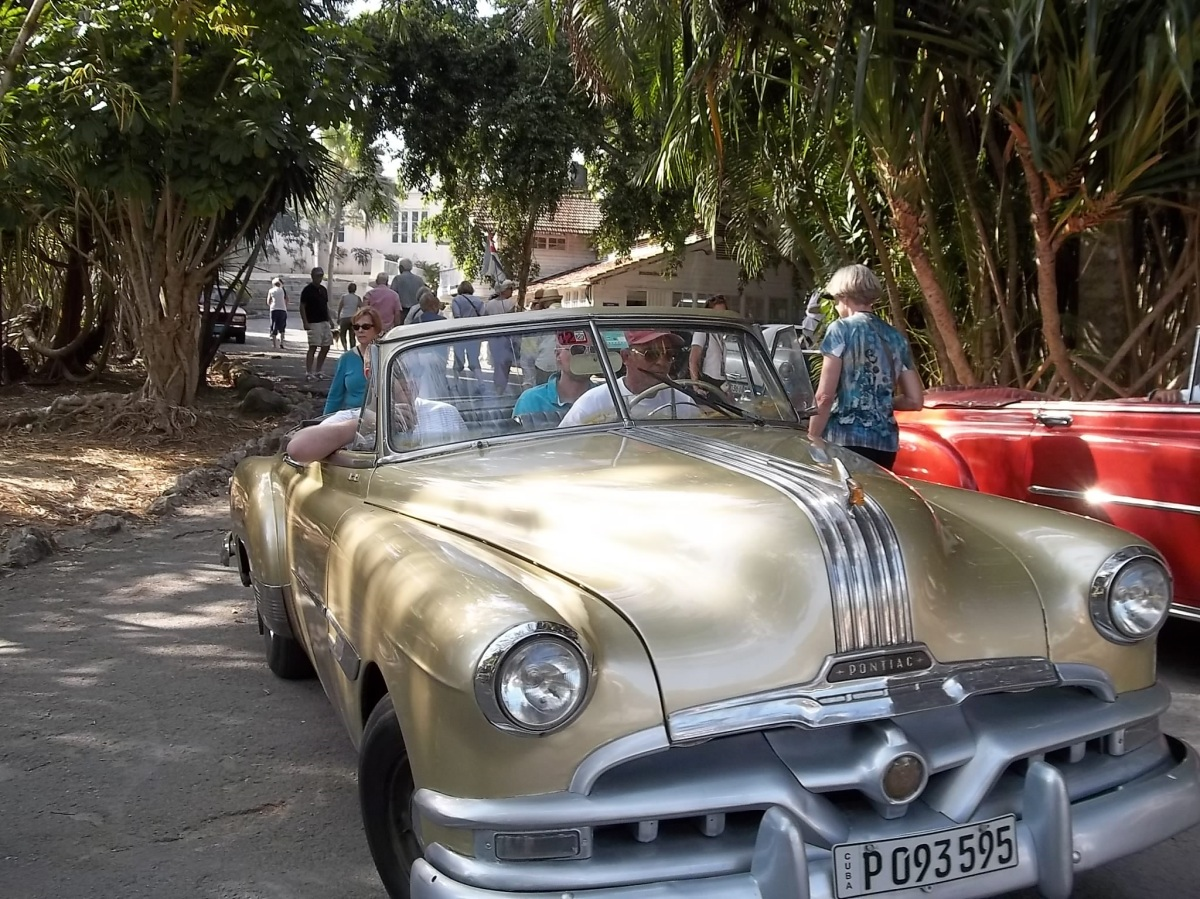Out for a spin in a restored Pontiac. Tourists and visitors love to see the vintage American cars lovingly maintained. For Cubanos, it's a necessity!
