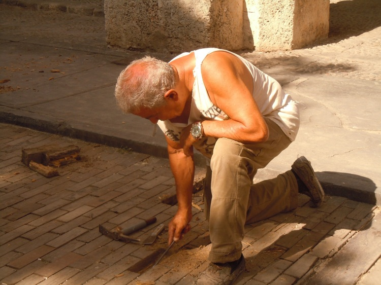Restoring paving in the historic district of Havana Vieja.