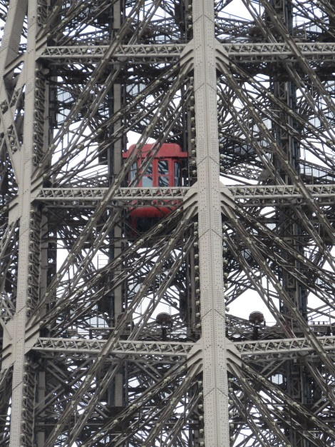 Closeup of the Tour Eiffel's little red elevator (Oct 2014) Bobbie Faul-Zeitler CC 3-0