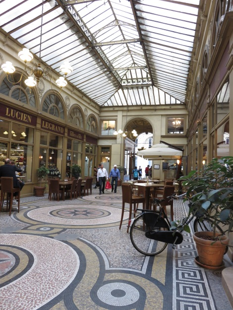 The Galerie Vivienne is one of the early 19th-century shopping arcades, beautifully restored and full of shops (Oct 2014) Bobbie Faul-Zeitler CC- 3.0