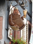 A Benedictine brother hoists a glass for the holidays in Alsace (France)> (Bobbie Faul-Zeitler, CC 3.0)