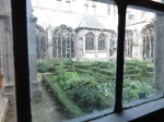 In the abbey complex at Middelburg, The Netherlands, a view of the herb garden through handmade glass. (Bobbie Faul-Zeitler, CC 3.0)