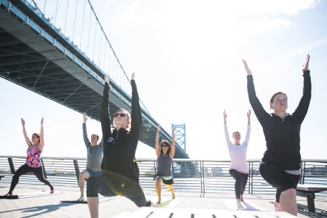 Race Street Pier yoga session Photo by R Kennedy for Philadelphia Visitor Association