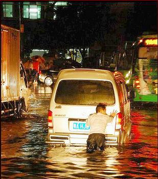 Low-lying areas of Guangzhou, China flood frequently. (Photo by Michael Ho)