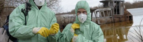 Christoph and Barbara Promberger get ready to place wolf traps for radio collarinjg. They are fully suited up to avoid contaminated soil or radioactive hair from wolves.