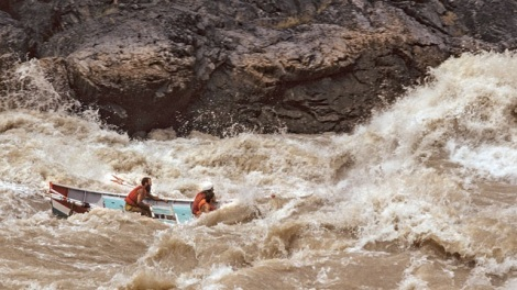 Kenton Grua (rear) hitting the Grand Canyon's Crystal Rapid with two guided clients in 1974