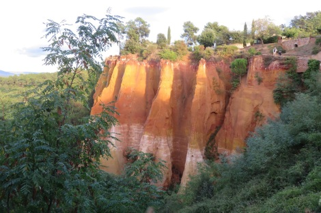The ocher cliffs in Roussillon France (The Luberon) were the source of pigments used by artists like Rembrandt. The whole town is saturated with different ocher tones in the stucco walls. (Roberta Faul-Zeitler, CC 3.0)