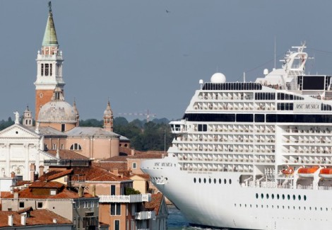 The MSC Musica cruise ship is seen in Venice lagoon in this June 16, 2012 file photo. Big cruise ships will be barred from Venice's Saint Mark's lagoon, to protect Italy's floating city from potential damage caused by growing traffic, the government said on August 8, 2014. REUTERS/Stefano Rellandini/Files