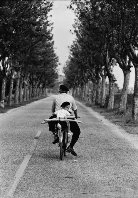 Boy on bicycle. Photograph by Elliott Erwitt.