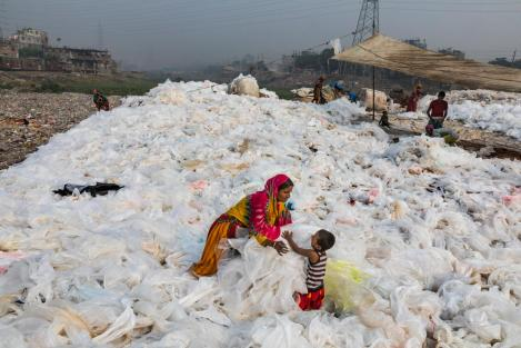 Plastic bags being washed in the Buringanga River, Bangladesh. Photo by Randy Olson, National Geographic.