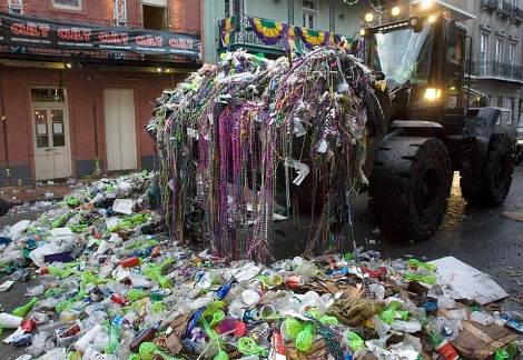 A front end loader removes trash that was left on Boubon Street after last night's Mardi Gras Celebration, Early Wednesday morning Feb. 25, 2009, in New Orleans. (AP Photo/Brian Lawdermilk)
