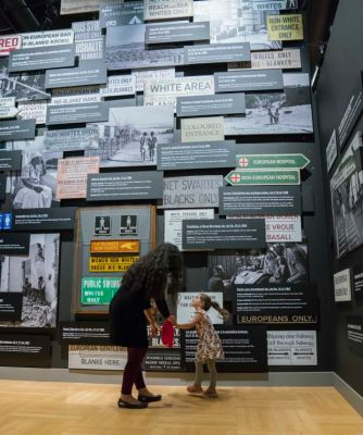 The Wall of Laws in the Mandela exhibition. Laws reinforced institutionalized segregation and lack of human rights. Photo by Jessica Sigurdson/CMHR