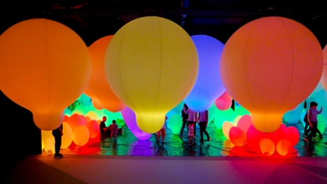 Weightless forest of resonating light requires visitors to navigate their way through the space. Inevitably they touch ad bump into the balloons which then change color.