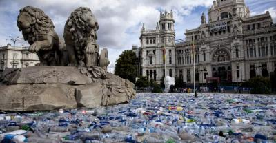 Cibeles Fountain Madrid full of recycled plastic bottles, part of the Plastic Islands Installation in 2017-18.