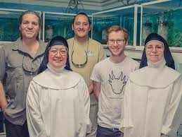 Sisters from the convent and Chester Zoo team. Sister Ofelia front row left. Photo via National Geographic