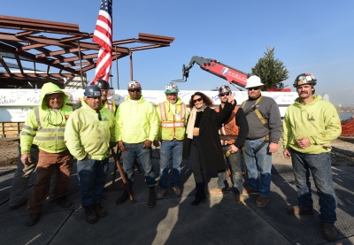 Fund-raising chair Diane von Furstenberg with construction crew at the new museum.